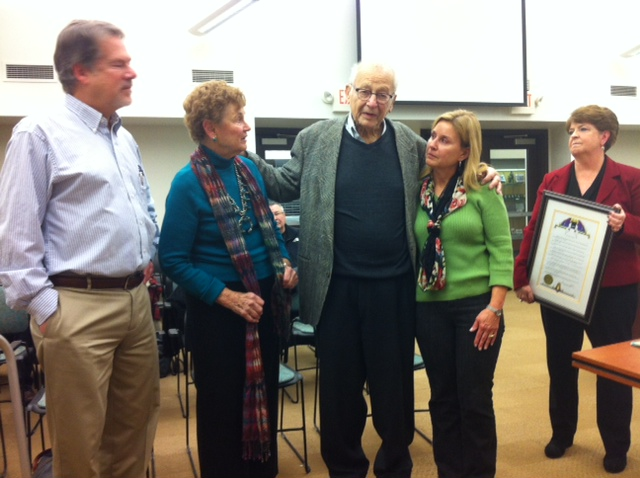 Isaac Young comments after receiving recognition from the Maplewood City Council. (Left to right: David,, son; Marilyn, wife; Young; Jodie, daughter-in-law; Karen Wood, council member