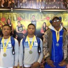 Ronald Stewart Gipson. Romelle (Tray) Person, Treyvon Williams with their medals.