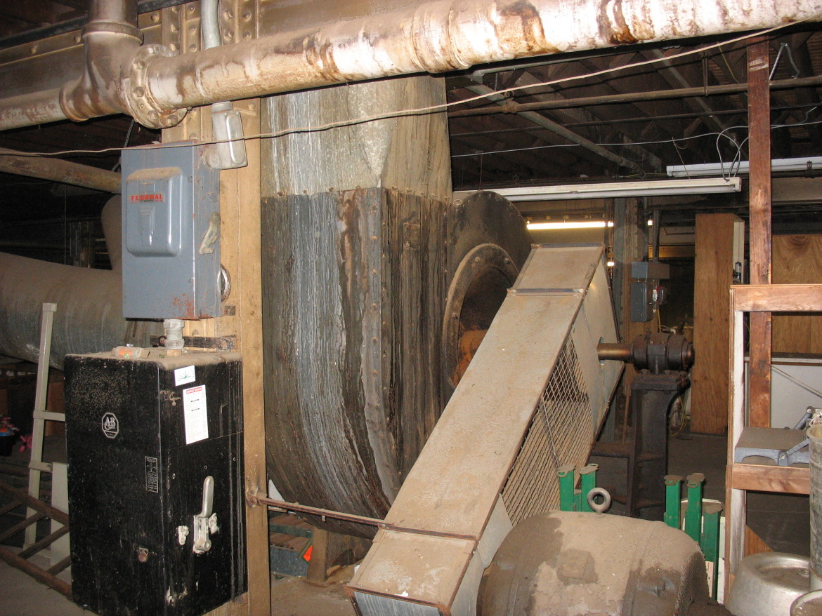 Inside the mill the dust collection system was driven by this powerful fan in the basement.