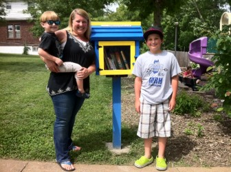 Nicole Skaggs with her sons, Cooper and Carson with the library in Highland Park, in Richmond Heights.