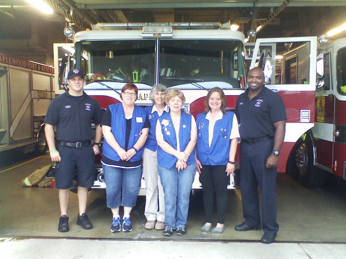 Lions Auxiliary Ladies Karen Bish, Eileen Lencz, Kathy Lubbers and Heidi Barks (left to right) fed Maplewood firefighters and police dinner Wednesday night.