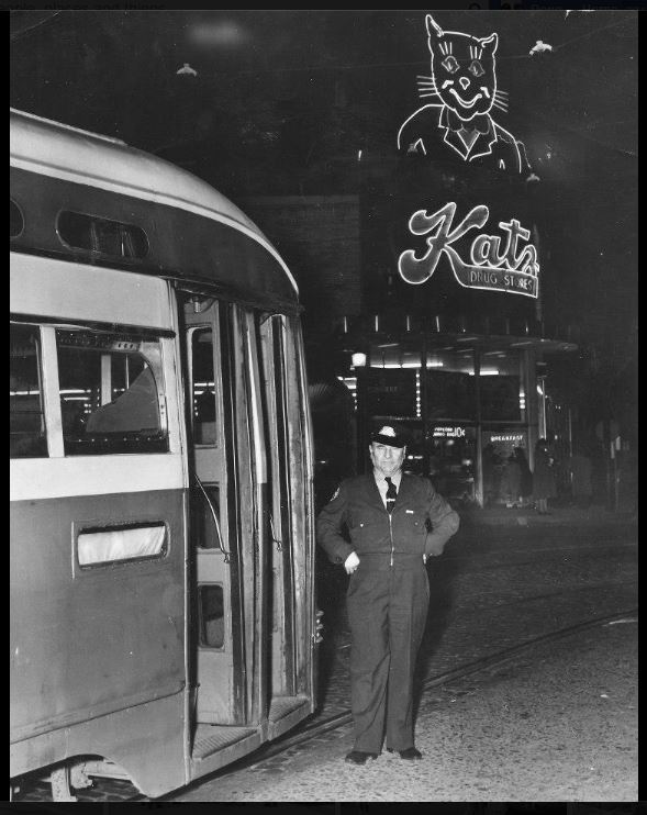 A night time view when the electric streetcars were still running. Also from 1949 which is the year the tracks were paved over after the service ended. I can't say for certain where this image was found.