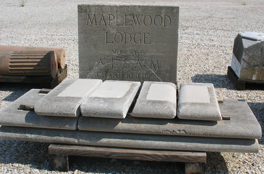 Pieces such as this cornerstone and what appears to be coping.
